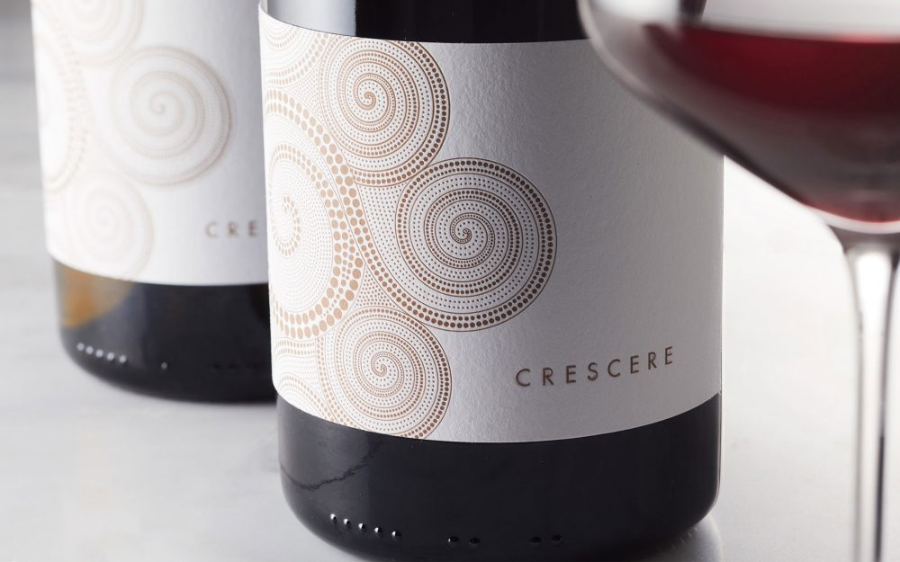 Crescere label front with glass of red wine in foreground